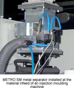 Protector metal separator for slow moving material column